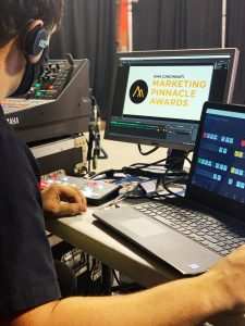 close up of A/V professional working laptop during program recording